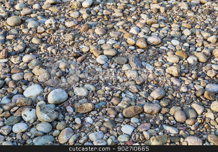 river pebbles background stock photo, a field of pebbles and rocks - a dry bed of mountain river by Marek Uliasz