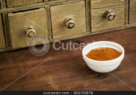 mangosteen fruit powder stock photo, mangosteen fruit powder  in a small bowl with a rustic drawer cabinet by Marek Uliasz
