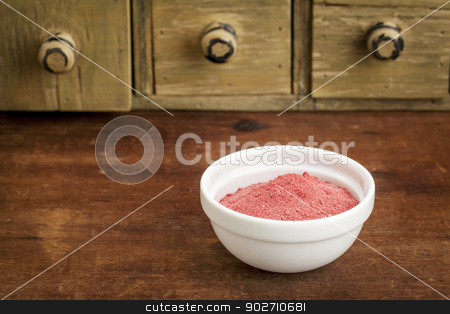 yumberry fruit powder stock photo, yumberry fruit powder in a small bowl with a rustic drawer cabinet by Marek Uliasz
