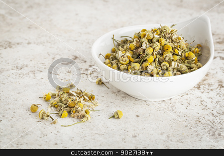 dried chamomile flowers stock photo, small ceramic bowl of  dried chamomile flowers against a ceramic tile background by Marek Uliasz