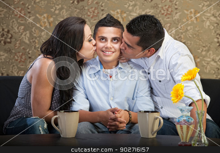 Son Kissed By Parents stock photo, Cute young man being kissed by parents by Scott Griessel