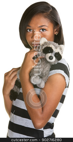Sad Teen with Toy stock photo, Sad Hispanic teenage girl holding plush raccoon doll by Scott Griessel