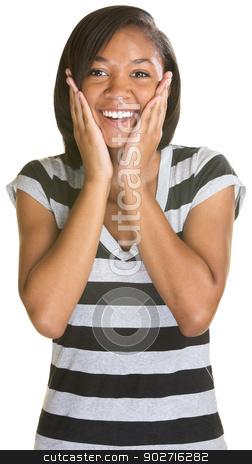 Teen With Hands on Cheeks stock photo, Joyful young woman in striped shirt with hands on cheeks by Scott Griessel