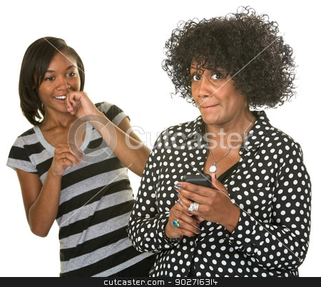 Embarrassed Lady with Phone stock photo, Embarrassed mature woman holding cell phone with laughing teen by Scott Griessel