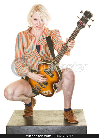 Grinning Guitar Player stock photo, Grinning female guitar player on isolated background by Scott Griessel