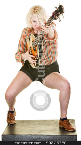 Frowning Guitar Player stock photo, Frowning guitar player dancing and performing on white by Scott Griessel