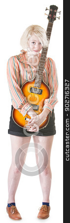 Coy Lady Holding Guitar stock photo, Coy blond female holding guitar on isolated background by Scott Griessel