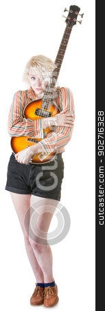 Timid Guitarist stock photo, Timid young European female hugging a guitar by Scott Griessel