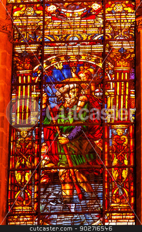 Moses Stained Glass Angel Statue Cathedral of Saint Mary of the  stock photo, Moses Stained Glass Angel Statue Seville Cathedral, Cathedral of Saint Mary of the See, Seville, Andalusia Spain.  Built in the 1500s.  Largest Gothic Cathedral in the World and Third Largest Church in the World.  Burial Place of Christopher Columbus. by William Perry