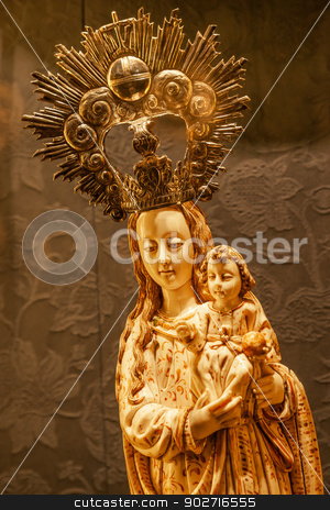 Mary Holding Baby Jesus Statue Seville Cathedral Spain stock photo, Mary Holding Baby Jesus Statue Seville Cathedral, Cathedral of Saint Mary of the See, Seville, Andalusia Spain.  Built in the 1500s.  by William Perry