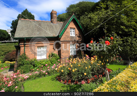 Little house with roses stock photo, Little house with roses in the garden by Juliet Photography