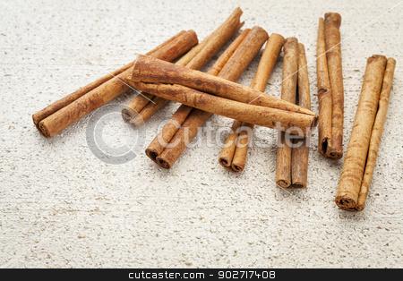 cinnamon sticks  stock photo, cinnamon sticks on a rough white painted barn wood background by Marek Uliasz