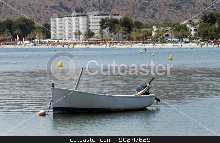 Alcudia beach stock photo, Scenic view of Alcudia beach with boat in foreground, Majorca, Spain. by Martin Crowdy