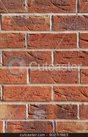 Brick wall background stock photo, Abstract textured background of red brick wall. by Martin Crowdy
