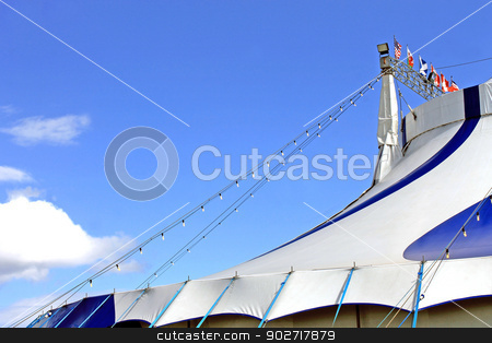 Circus tent stock photo, Circus big top tent with blue sky and cloudscape background. by Martin Crowdy