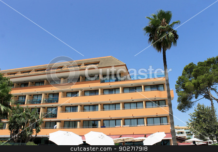 Spanish hotel and palm tree stock photo, Scenic view of Spanish tourist hotel and palm tree, Majorca, Spain. by Martin Crowdy