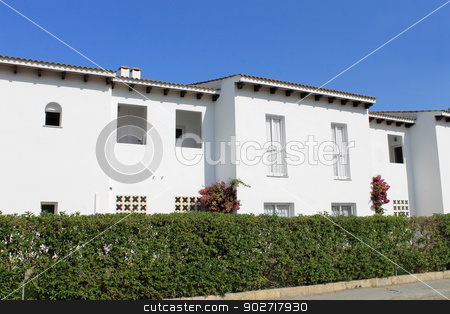 White Spanish houses stock photo, Exterior of white Spanish houses with blue sky background. by Martin Crowdy