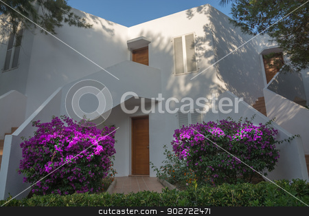 White Ibiza-style building in Cala d'Or, Majorca. stock photo, White Ibiza-style building in Cala d'Or, Majorca with blossoming bougainvilleas welcoming. by ArtesiaWells