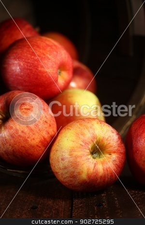 Red Apples on Wood Grunge  Background stock photo, Rustic Barrel Full of Red Apples on Wood Grunge  Background by Katrina Brown