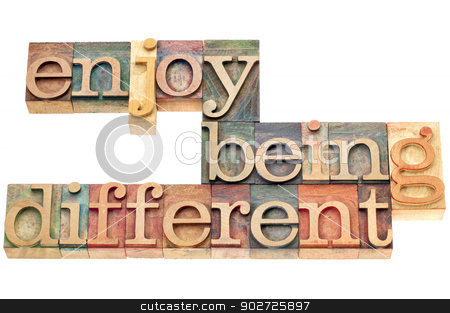 enjoy being different  stock photo, enjoy being different advice - lifestyle or nonconformist concept - isolated text in letterpress wood type by Marek Uliasz