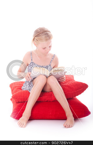 girl reads a book on red cushions stock photo, girl reads a book on red cushions against white background by anton havelaar