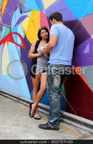 Couple Talking stock photo, A Couple standing together and talking. by Henrik Lehnerer