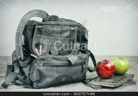 School Theme Still Life stock photo, Still Life With An Old Backpack, Books And Apples  by Sergej Razvodovskij
