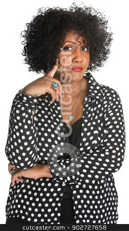 Skeptical Woman in Polka Dot stock photo, Skeptical woman with folded arms over isolated background by Scott Griessel