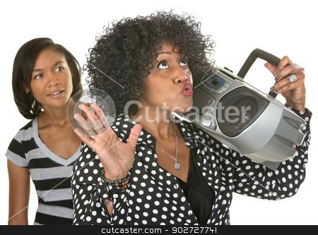 Singing Woman with Radio and Teen stock photo, Singing middle aged woman with radio near curious teenager by Scott Griessel
