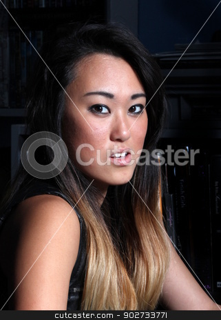 Indonesien Woman stock photo, Close up portrait of an indonesian woman. by Henrik Lehnerer