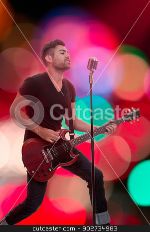 performer with guitar stock photo, male performer singing live performance with guitar by mandygodbehear