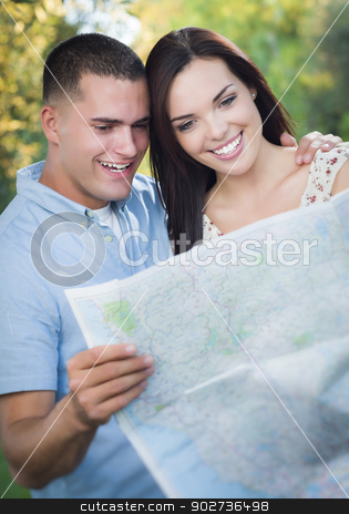 Mixed Race Couple Looking Over Map Outside Together stock photo, Happy Mixed Race Couple Looking Over A Map Outside Together. by Andy Dean