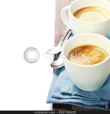 coffee stock photo, two cups of coffee with blue napkin by klenova