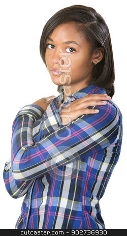 Sad Teenager Holds Shoulders stock photo, Serious teenage girl with hands on shoulders by Scott Griessel
