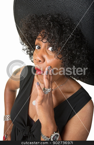 Cute Black Woman Whispering stock photo, Beautiful mature woman with hand by mouth whispering by Scott Griessel
