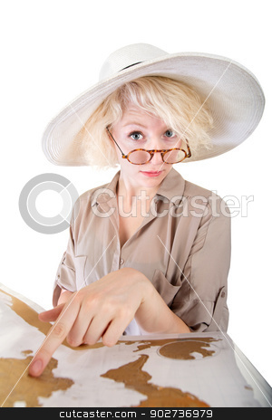 Cute Lady Pointing at Map stock photo, Cute European woman in safari hat pointing at map by Scott Griessel