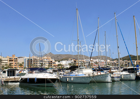Alcudia harbor and marina stock photo, ALCUDIA HARBOR, MAJORCA, SPAIN - 4th August 2013: Alcudia Bay resort on the 4th August 2013. This is a popular tourist destination every summer, particularly from visitors from European countries. by Martin Crowdy