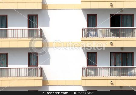 Balconies on hotel building stock photo, Closeup of hotel building with balconies and windows. by Martin Crowdy