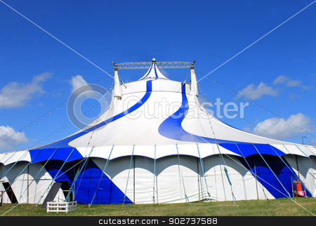 Blue circus tent in green field stock photo, Blue circus tent in a green field by Martin Crowdy