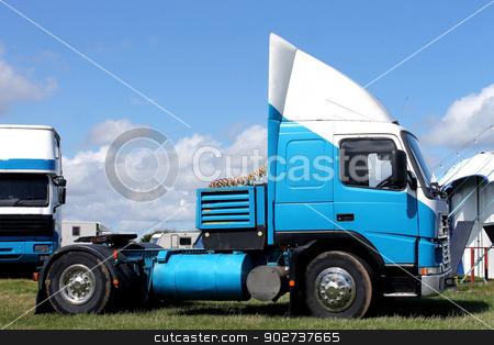 Circus trucks in field stock photo, Circus trucks in field by big top tent by Martin Crowdy