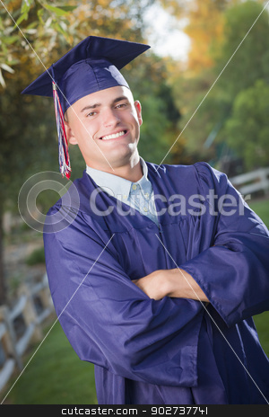 Handsome Male Graduate in Cap and Gown stock photo, Happy Handsome Male Graduate in Cap and Gown Outside. by Andy Dean