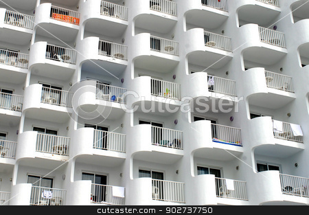 Hotel balconies stock photo, Exterior of modern hotel building with towels hung over white balconies. by Martin Crowdy