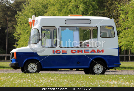 Ice cream van stock photo, Ice cream van parked in green countryside. by Martin Crowdy