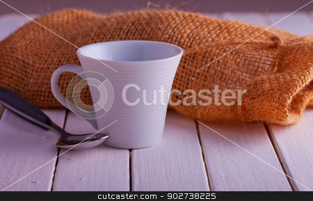 Coffee stock photo, Close up of a cup of coffee over white wood by Fabio Alcini