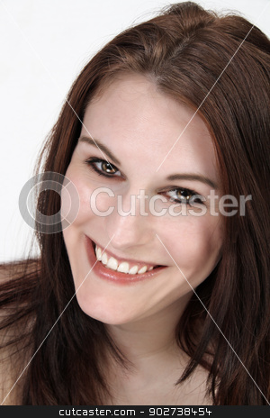 Beautiful, Smiling Brunette Headshot stock photo, A close-up of a lovely young brunette with a bright, warm smile. by Carl Stewart