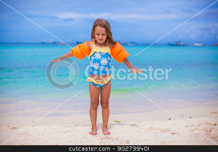 Beautiful little girl spread her arms standing at the beach stock photo, Beautiful little girl spread her arms standing at the beach by Dmitry Travnikov