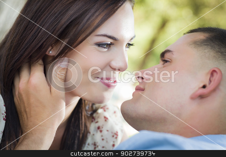 Mixed Race Romantic Couple Portrait in the Park stock photo, Happy Mixed Race Romantic Couple Portrait in the Park. by Andy Dean