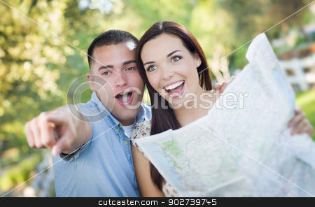 Mixed Race Couple Looking Over Map Outside Together stock photo, Happy Mixed Race Couple Looking Over A Map and the Sites Outside Together. by Andy Dean