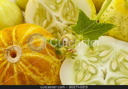 lemon cucumbers stock photo, background of lemon (or apple) cucumbers with cross section and leaves by Marek Uliasz