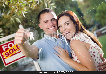 Military Couple with House Keys and Sold Real Estate Sign stock photo, Mixed Race Excited Military Couple with New House Keys and Sold Real Estate Sign Outside. by Andy Dean